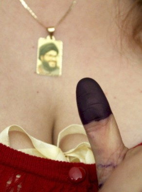 A Lebanese voter shows her ink-stained finger at a polling station in Zahle in the Bekaa valley