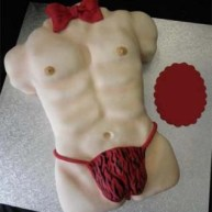 Cheetah g-string Tarzan body and red bow macho x-rated cake