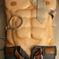 erotic man's chest and tie jeans and belt and handcuffs cake