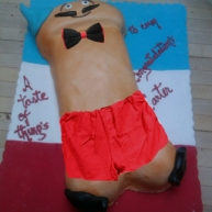 French dick man shorts bow tie and mustache dick cake