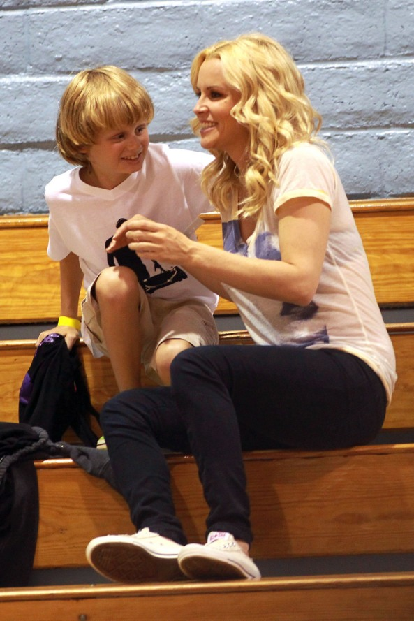 Jenny McCarthy, her son Evan and her boyfriend Jason Toohey cheer on Jenny's sister JoJo during a lingerie basketball game in LA